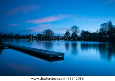 Calm blue sunset at lake - stock photo