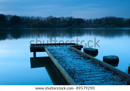 Calm blue sunset at lake - stock photo