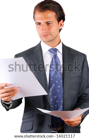 Calm Businessman reading papers - stock photo