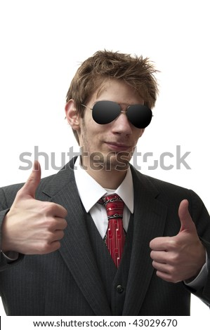 "Calm, cool, and collected businessman has both of his thumbs up, reassuring the viewer with a big ""yes"" - stock photo"