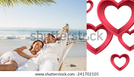 Calm couple napping in a hammock against pink hearts - stock photo