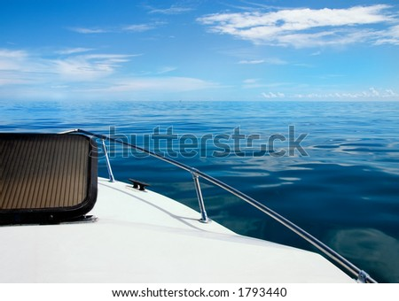 Calm day on Atlantic Ocean over bow of boat - stock photo