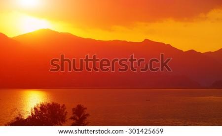 calm evening landscape with lake and mountains. Feva lake, Nepal. - stock photo