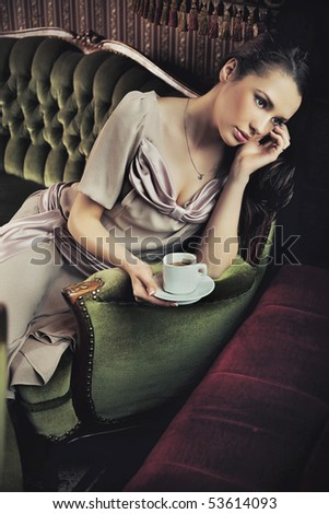 Calm lady drinking coffee