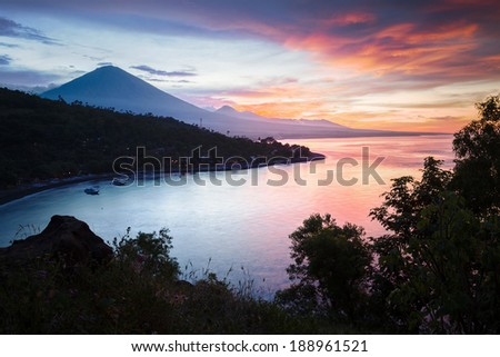 Calm lagoon with mountains on the background at sunset. Bali, Indonesia