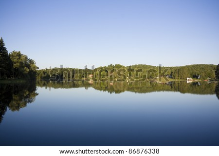 Calm lake water shot in muskoka cottage country ontario - stock photo