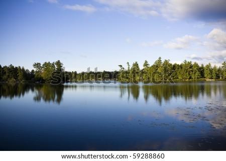 Calm lake water shot in Muskoka, Ontario Cottage Country - stock photo