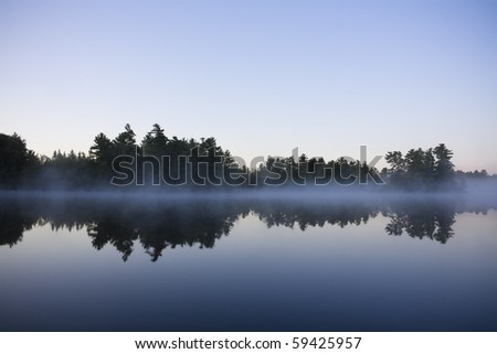 Calm lake water shot in Muskoka, Ontario Cottage Country - stock photo