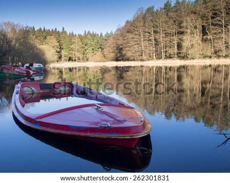 Calm lake with boats, Ireland - stock photo