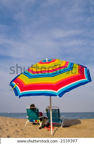 calm lazy afternoon at the beach under the umbrella