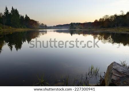 Calm Mountain Lake at Dawn - stock photo