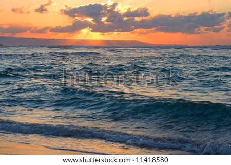Calm peaceful ocean and beach on tropical sunrise