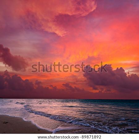 Calm peaceful ocean and beach on tropical sunrise. Bali, Indonesia - stock photo