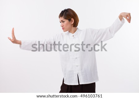 calm, peaceful, strong, confident asian woman practice kungfu or tai chi quan, baguazhang, chinese martial arts concept