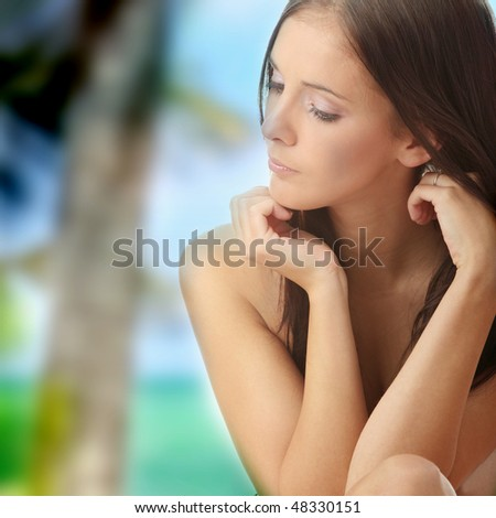 Calm portrait of young  beautiful woman - stock photo