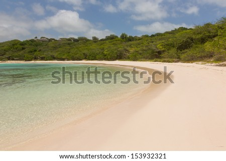 Calm Sandy Tropical Beach at Half Moon Bay Antigua - stock photo
