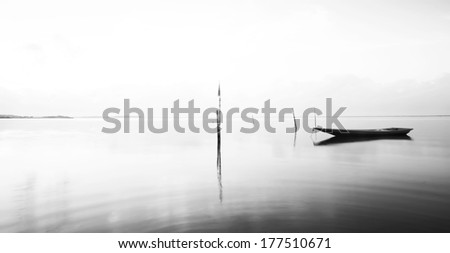 Calm scene in black and white with fisherman boat parking. black and white (fine art)  - stock photo