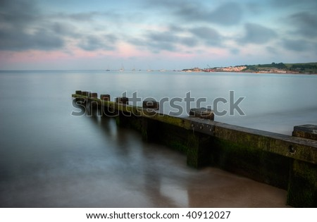 Calm sea at sunset in Swanage, Dorset (England) - stock photo