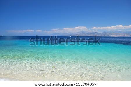 Calm sea blue water ocean sky horizon scenic in Mediterranean - stock photo