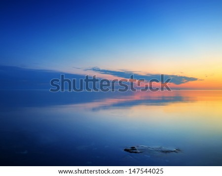 Calm sea during sundown. Beautiful summer seascape - stock photo