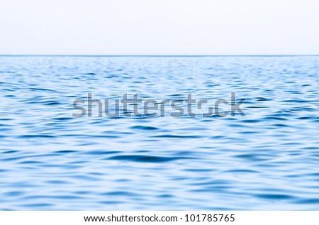 Calm sea extending to the horizon - stock photo