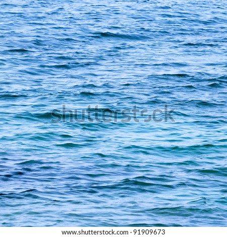 Calm sea extending to the horizon - stock photo