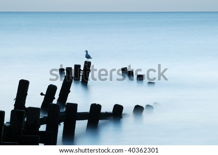 Calm sea lit by moonlight, Hopton-on-Sea, Norfolk, UK - stock photo