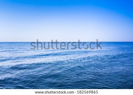 Calm sea ocean and blue clear sky - stock photo