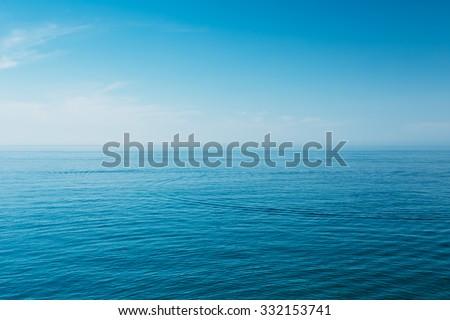 Calm Sea Ocean And Blue Sky Background - stock photo
