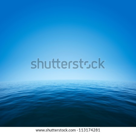 Calm sea with distorted surface and blue clear sky - stock photo