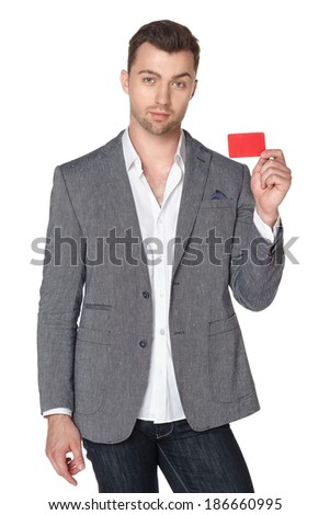 Calm smiling business man showing blank businesscard, isolated over white background - stock photo