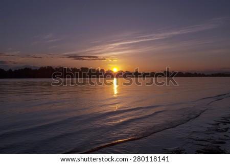 Calm sunrise on the river - stock photo