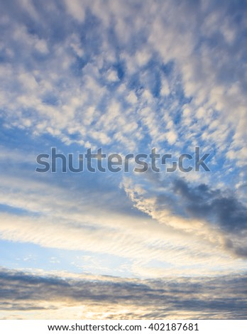 Calm sunset clouds and blue sky - stock photo
