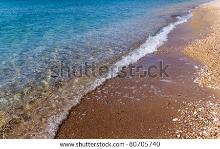 Calm waves on the beach - stock photo