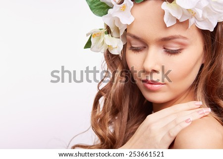Calm woman in floral wreath - stock photo