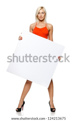 Calm woman in full length holding empty banner, over white background