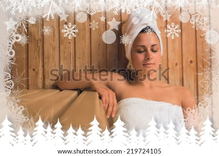 Calm woman relaxing in a sauna against fir tree forest and snowflakes - stock photo