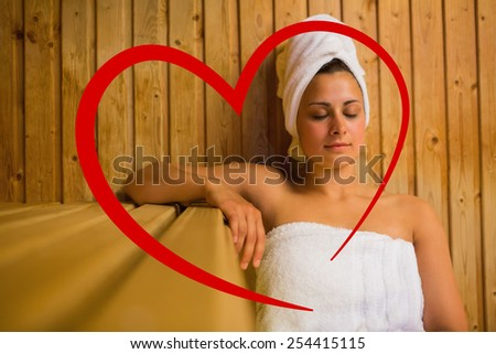 Calm woman relaxing in a sauna against heart - stock photo