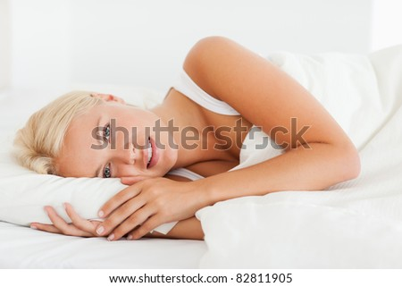 Calm woman waking up in her bedroom