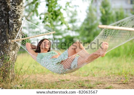 calm young woman sleep on hammock in the park