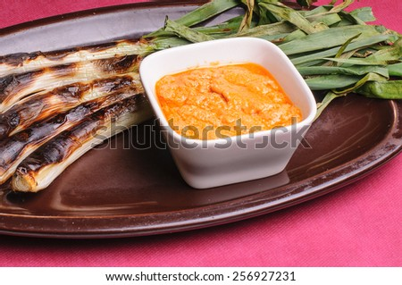 calsot spring onion is a typical dish in catalonia spanish - stock photo