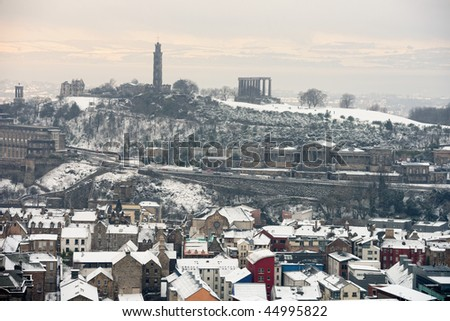 Calton Hill, Edinburgh, Scotland, UK, from the south, in the snow.  Fife is just visible across the Firth of Forth. - stock photo