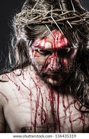 calvary jesus, man bleeding, representation of passion - stock photo