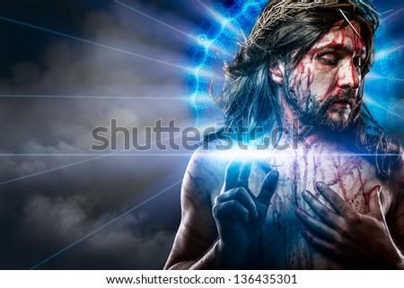 calvary jesus, man bleeding, representation of passion with blue light halo - stock photo