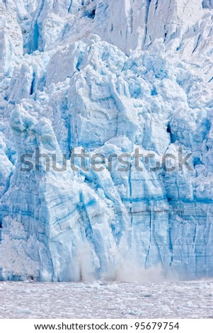 Calving glacier melting into ocean - stock photo