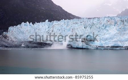 Calving Marjorie Glacier in Glacier Bay National Park and Preserve, Alaska - stock photo