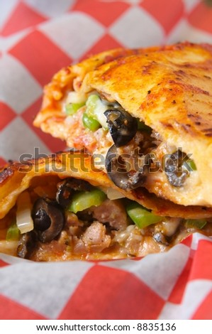 Calzone in a basket cut open - stock photo