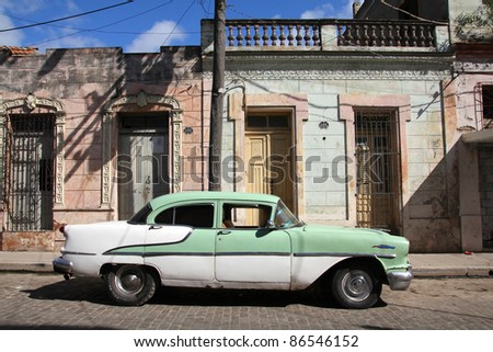 CAMAGUEY, CUBA - FEBRUARY 17: Classic American car parked in the street on February 17, 2011 in Camaguey, Cuba. The multitude of oldtimer cars in Cuba is its major tourism attraction. - stock photo