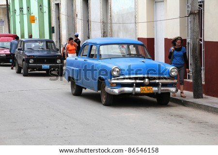 CAMAGUEY, CUBA - FEBRUARY 16: Classic American car parked in the street on February 16, 2011 in Camaguey, Cuba. The multitude of oldtimer cars in Cuba is its major tourism attraction. - stock photo