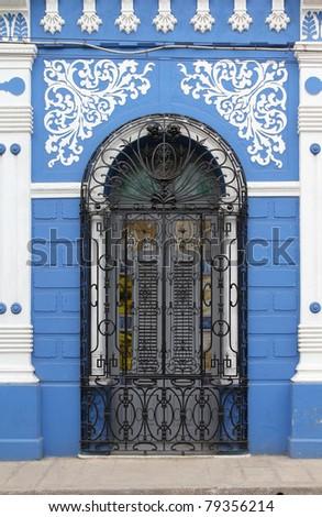 Camaguey, Cuba - old town listed on UNESCO World Heritage List. Ornate door of Casa de la Cultura. - stock photo